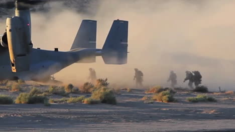 Us-Marines-Board-An-Osprey-Helicopter-In-The-Desert-And-It-Takes-Off