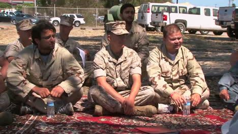 Afghan-Role-Players-Engage-With-Marines-In-A-Simulation-Of-Conditions-In-Afghanistan-3