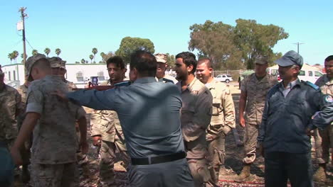Afghan-Role-Players-Engage-With-Marines-In-A-Simulation-Of-Conditions-In-Afghanistan-5