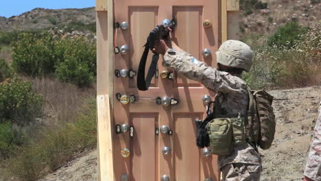 Us-Army-Troops-Are-Taught-To-Break-Down-Doors-As-Part-Of-An-Advance