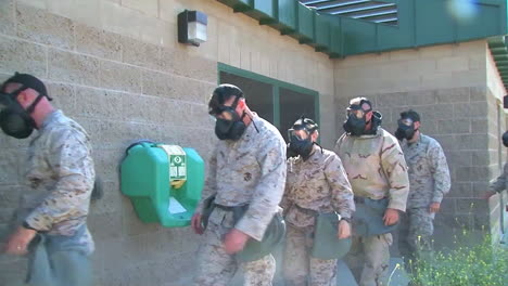 Us-Marines-Conduct-Poison-Gas-Experiments-Wearing-Gas-Masks
