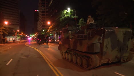Police-And-Marines-Roll-Out-Tanks-And-Armored-Vehicles-Through-An-American-City-During-Times-Of-Public-Unrest-And-Rioting-1
