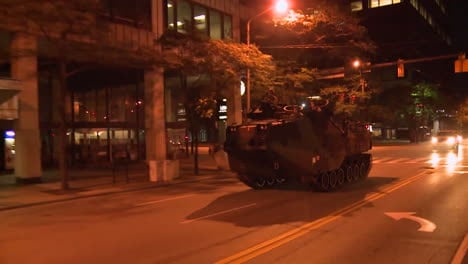 Police-And-Marines-Roll-Out-Tanks-And-Armored-Vehicles-Through-An-American-City-During-Times-Of-Public-Unrest-And-Rioting-2