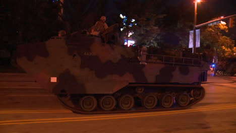 Police-And-Marines-Roll-Out-Tanks-And-Armored-Vehicles-Through-An-American-City-During-Times-Of-Public-Unrest-And-Rioting-3