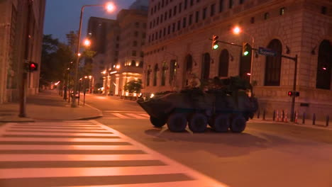 Police-And-Marines-Roll-Out-Tanks-And-Armored-Vehicles-Through-An-American-City-During-Times-Of-Public-Unrest-And-Rioting-4