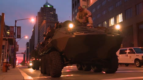 Police-And-Marines-Roll-Out-Tanks-And-Armored-Vehicles-Through-An-American-City-During-Times-Of-Public-Unrest-And-Rioting-5