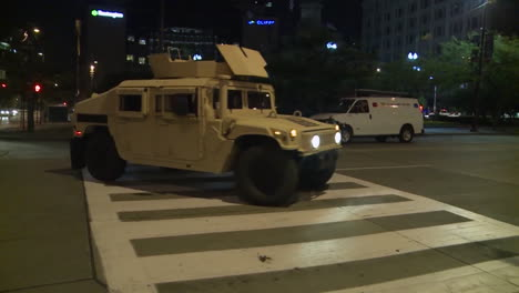 Police-And-Marines-Roll-Out-Tanks-And-Armored-Vehicles-Through-An-American-City-During-Times-Of-Public-Unrest-And-Rioting-7