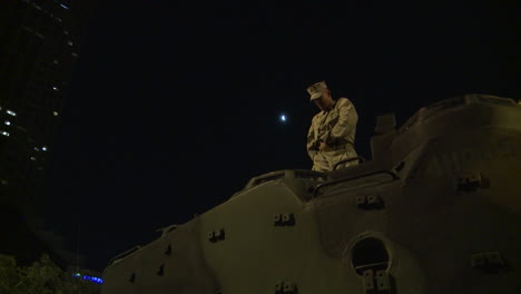 Police-And-Marines-Roll-Out-Tanks-And-Armored-Vehicles-Through-An-American-City-During-Times-Of-Public-Unrest-And-Rioting-14