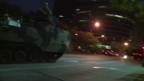 Police-And-Marines-Roll-Out-Tanks-And-Armored-Vehicles-Through-An-American-City-During-Times-Of-Public-Unrest-And-Rioting-16