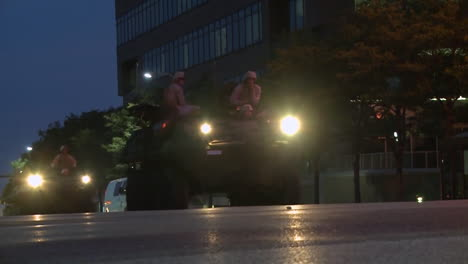 Police-And-Marines-Roll-Out-Tanks-And-Armored-Vehicles-Through-An-American-City-During-Times-Of-Public-Unrest-And-Rioting-17
