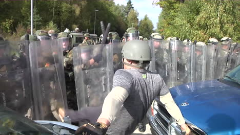 Rioters-And-Protesters-Meet-Police-Troops-And-Tear-Gas-During-A-Mock-Demonstration-1