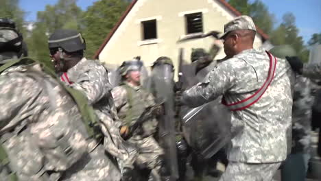 Rioters-And-Protesters-Meet-Police-Troops-And-Tear-Gas-During-A-Mock-Demonstration-2