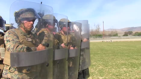Troops-Practice-A-Defensive-Formation-Against-Rioters