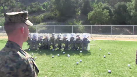 Troops-Practice-Being-Hit-By-Thrown-Objects-During-A-Riot