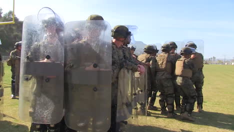 Troops-Practice-A-Defensive-Formation-Against-Rioters-1