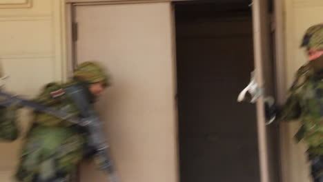A-Marine-Swat-Team-Performs-A-Simulated-Hostage-Rescue-Mission-2