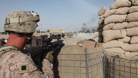An-American-Soldier-Looks-Out-From-An-Outpost-Over-War-Torn-Iraq