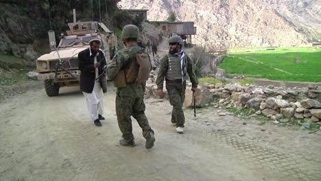 Us-Troops-Walk-Through-A-Village-On-Patrol-In-Tantil-Valley-Region-Of-Konar-Afghanistan