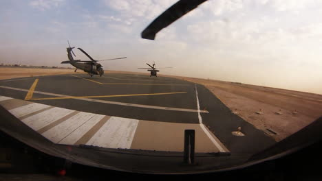 A-Squadron-Of-Helicopters-Fly-In-Formation-Over-Afghanistan