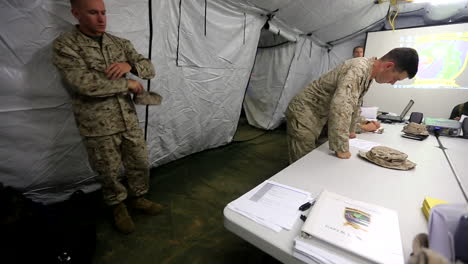 Us-Troops-Are-Briefed-On-A-Mission-Inside-A-Large-Army-Tent-1