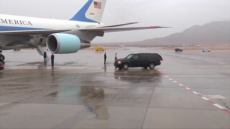 President-Obama-Arrives-At-Airforce-One-In-A-Motorcade-On-A-Rainy-Day