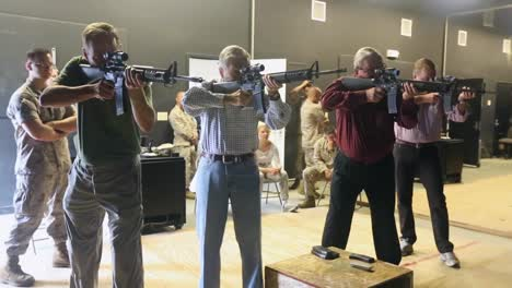 Former-California-Governor-Pete-Wilson-Fires-Guns-With-The-Army-At-A-Photo-Op