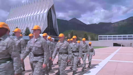 Recent-Graduates-Walk-In-Formation-In-Front-Of-The-Air-Force-Academy-In-Colorado