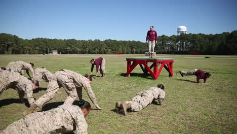 Female-Soldiers-In-Basic-Training-Do-Exercises-On-An-Outdoor-Field-1