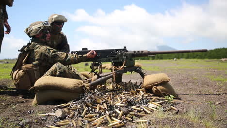 Soldiers-Engage-In-A-Live-Fire-Exercise-With-Machine-Guns-On-A-Battlefield-In-Japan