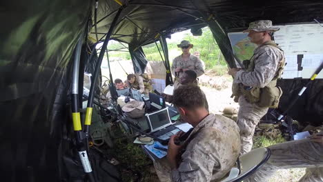 Us-Troops-At-Work-At-A-Mobile-Command-Center-In-The-Field