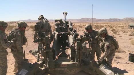 Us-Marines-Fire-Artillery-In-The-Desert