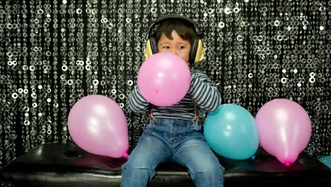 Young-Boy-Playing-With-Balloons-16