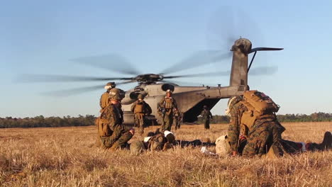 American-Wounded-Undergo-Transportation-To-A-Field-Hospital-By-Helicopter-During-Simulated-Battle-6
