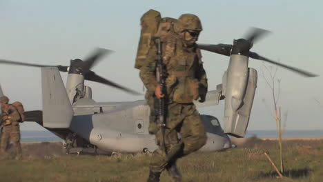 American-Marines-Emerge-From-Osprey-Helicopters-On-A-Simulated-Mission-1