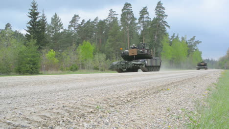 Us-Army-Tanks-Head-Down-A-Forested-Road