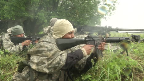 French-Infantry-Perform-Intense-Simulated-Battlefield-Conflicts-In-A-Forest-Environment