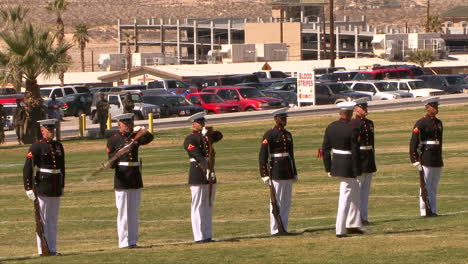 The-United-State-Marine-Corp-Marching-Band-And-Color-Guard-Practice-On-A-Playing-Field