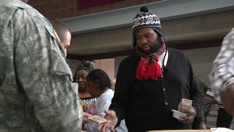 New-Jersey-National-Guard-Troops-Hand-Out-Food-To-Survivors-Of-Hurricane-Sandy-At-A-Refugee-Center