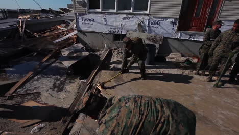 Marines-And-Army-Troops-Search-Through-Ruined-Homes-Following-Hurricane-Sandy-1