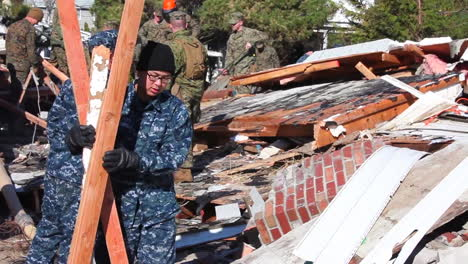 Marines-And-Army-Troops-Search-Through-Ruined-Homes-Following-Hurricane-Sandy-4