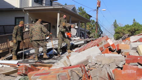 Marines-And-Army-Troops-Search-Through-Ruined-Homes-Following-Hurricane-Sandy-6