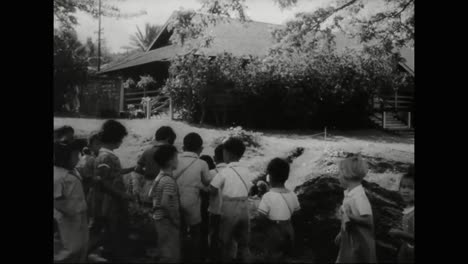 Martial-Law-Is-Declared-In-Hawaii-Following-The-Bombing-Of-Pearl-Harbor-In-1941-And-Schoolchildren-Learn-To-Don-Gas-Masks