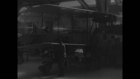 Airplanes-And-Blimps-Are-Rolled-Out-Of-A-Factory-In-Italy-In-1914
