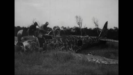 Soldiers-Look-At-The-Destroyed-Wreckage-Of-Planes-And-Other-War-Materials-From-The-Pacific-Islands-During-World-War-Two