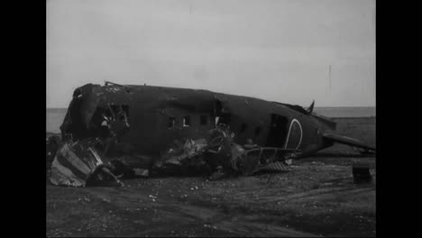 Soldiers-Look-At-The-Destroyed-Wreckage-Of-Planes-And-Other-War-Materials-From-The-Pacific-Islands-During-World-War-Two-1