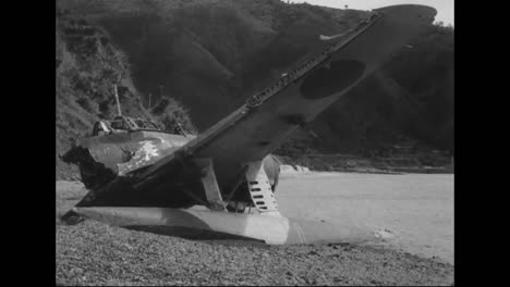 Soldiers-Look-At-The-Destroyed-Wreckage-Of-Planes-And-Other-War-Materials-From-The-Pacific-Islands-During-World-War-Two-3
