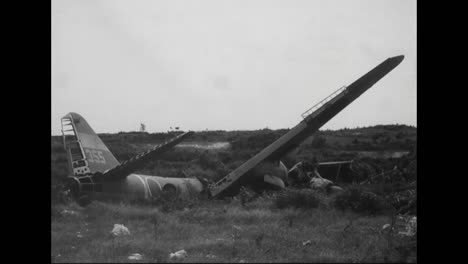 Soldiers-Look-At-The-Destroyed-Wreckage-Of-Planes-And-Other-War-Materials-From-The-Pacific-Islands-During-World-War-Two-4