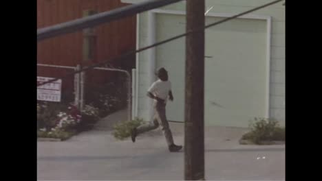 In-The-1970S-A-Young-African-American-Boy-Wanders-Aimlessly-Through-The-Ghetto-1