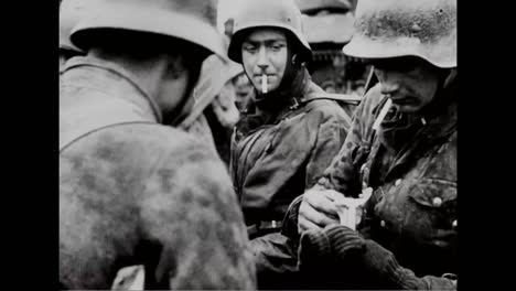 Captured-German-War-Film-Shows-German-Troops-In-Late-1944-Smoking-Cigarettes-From-Dead-American-Soldiers