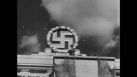 Allied-Troops-Sieze-The-Stadium-Of-Nuremburg-And-Blow-Up-The-Nazi-Symbol-On-Top-Of-It-Signalling-The-Defeat-Of-Germany-And-The-End-Of-World-War-Two